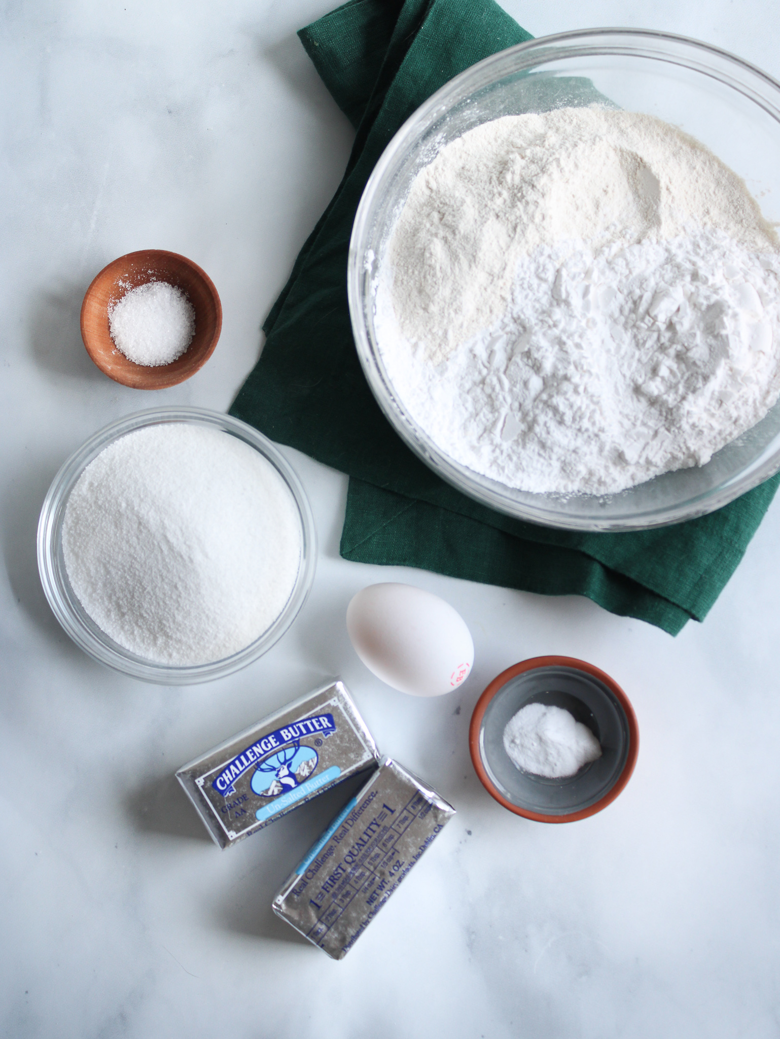 Gluten free cut out sugar cookie ingredients cassava flour, arrowroot starch, sugar, butterm egg, salt, baking soda and vanilla