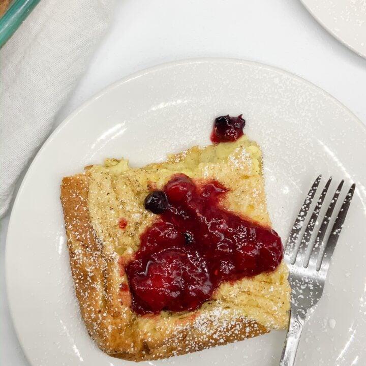 Homemade fresh berry syrup on top of gluten free German pancake.