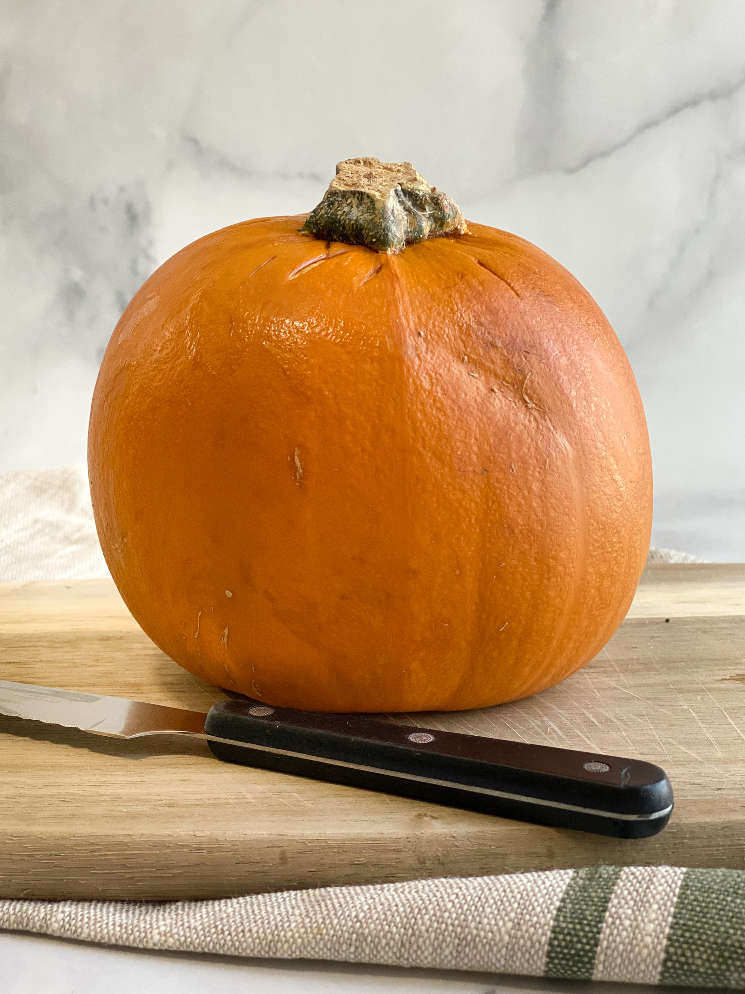 Step 3 - Bake the whole pumpkin in a 350 degree oven for about 45 minutes to an hour or until it is soft and slightly darker in color. Allow it cool to the touch before moving on.