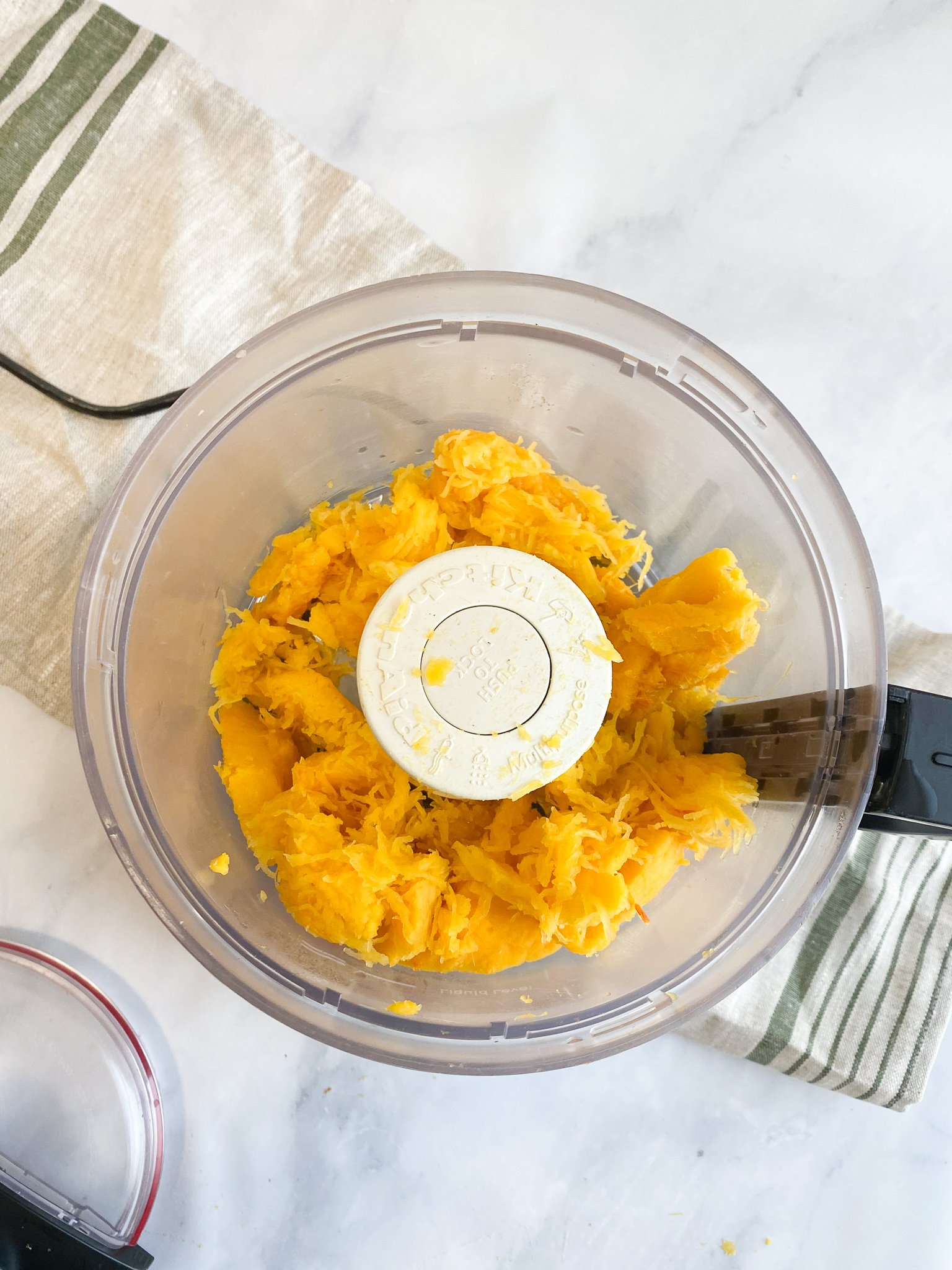 Step 6 - Remove the flesh of the pumpkin from the skin and transfer it to a food processor or blender and blend until it's smooth.