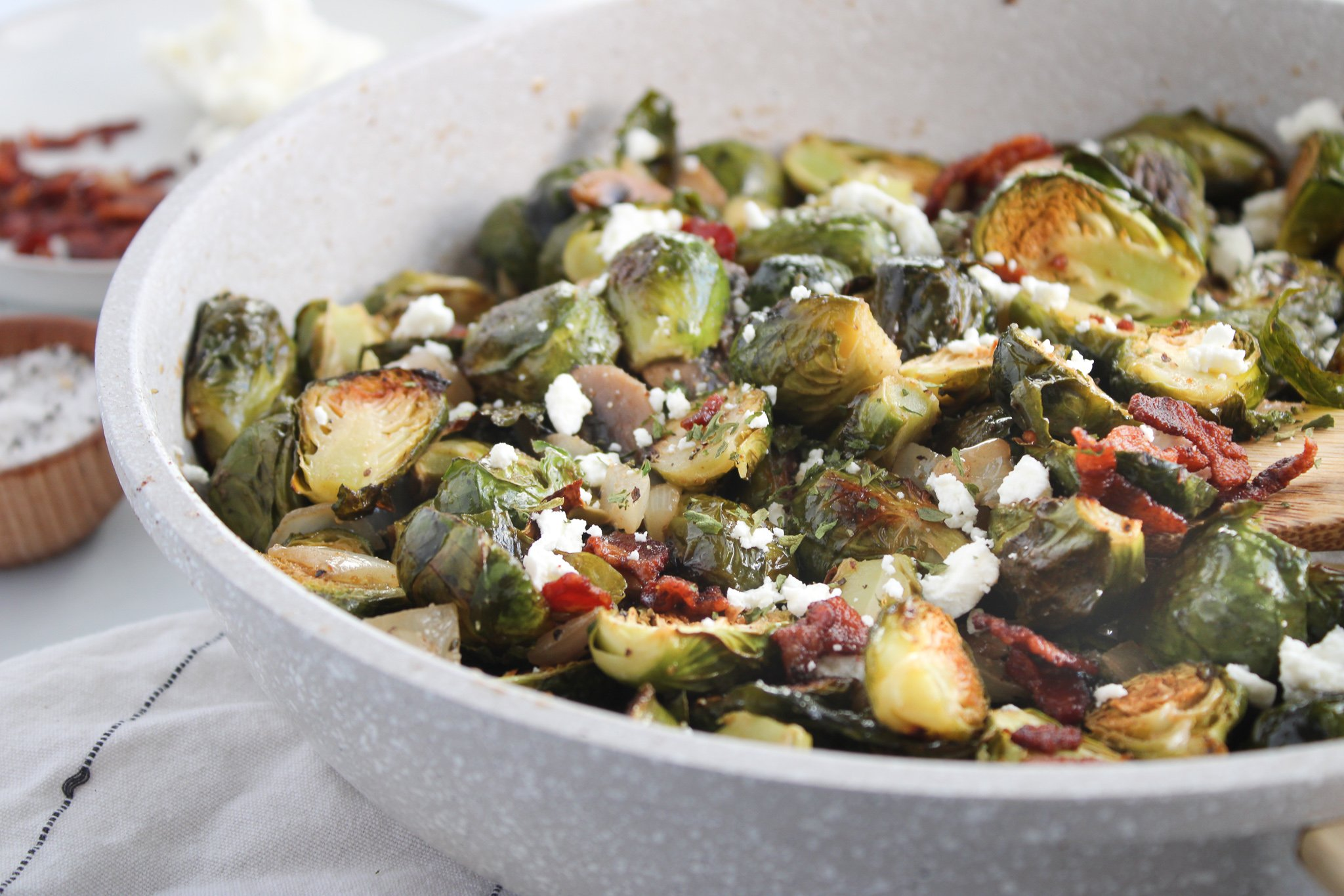 Brussel sprouts with bacon, mushrooms, onions, in a honey dijon sauce with crumbled goat cheese
