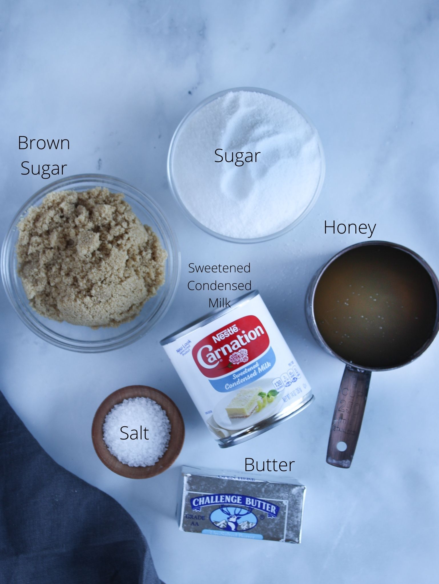 Homemade soft caramel candy ingredients sugar, brown sugar, honey, sweetened condensed milk, butter and salt