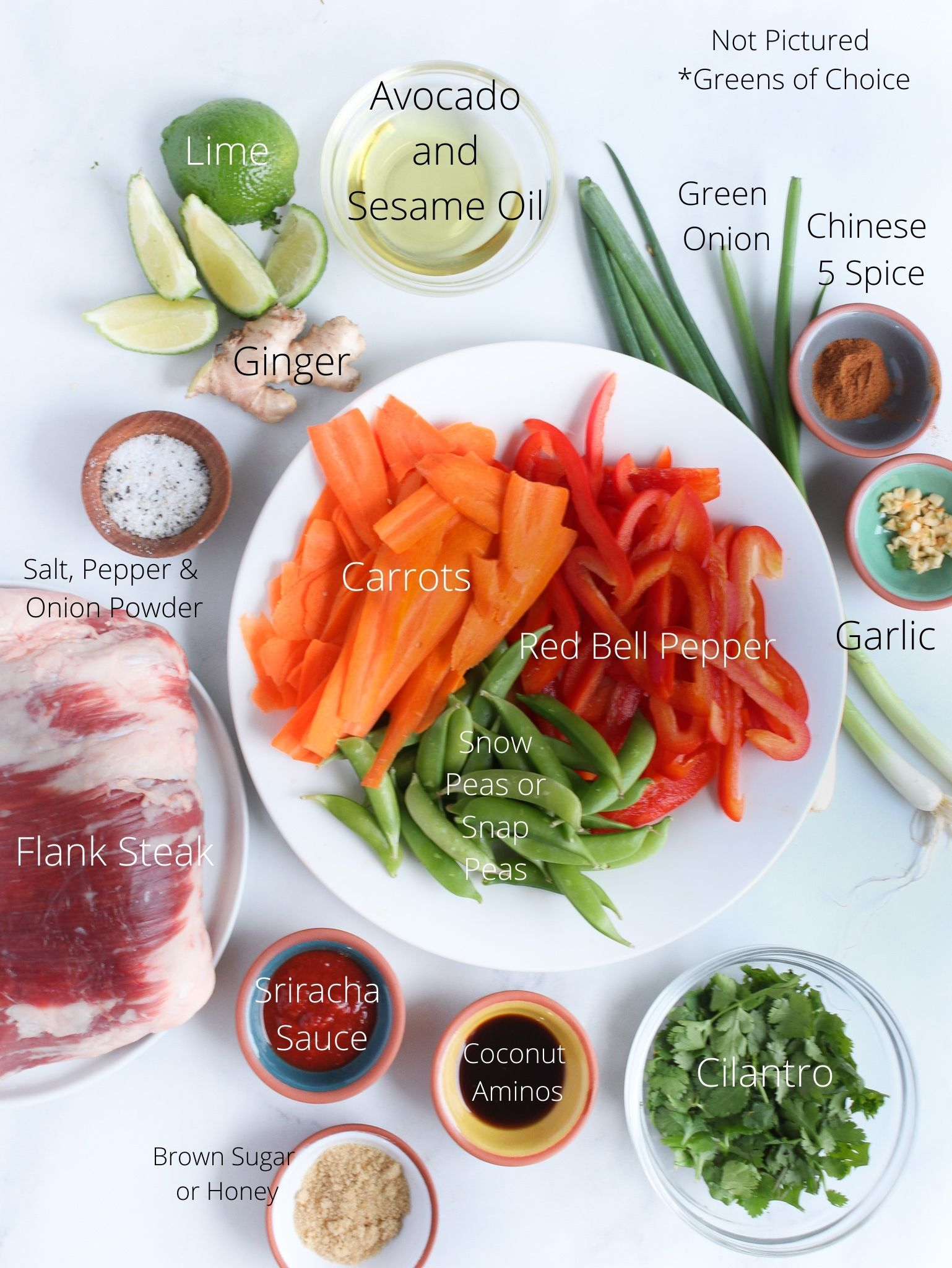 Asian Steak Salad Ingredients laid out with the flank steak, bell peppers, carrots and snap peas, green onion, cilantro and all the spices that make it delicious.