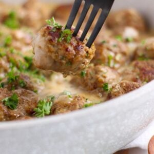 Swedish meatballs on a fork representing the beef category cover image