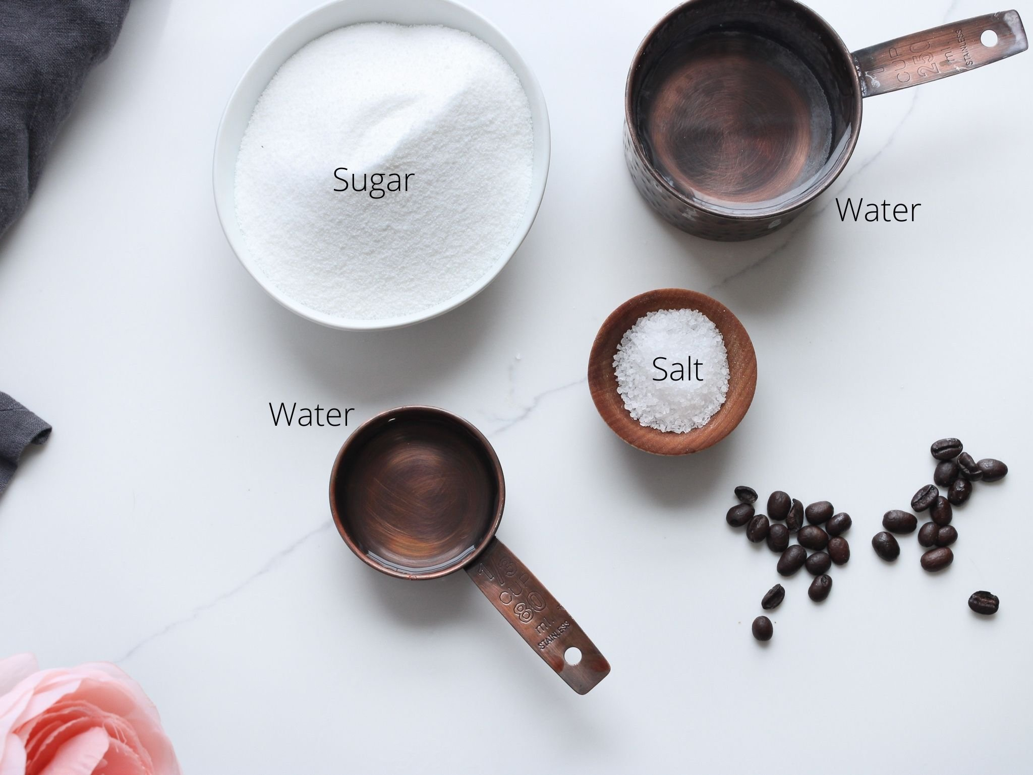 Caramel coffee ingredients laid out which are sugar, water and salt, which is optional.