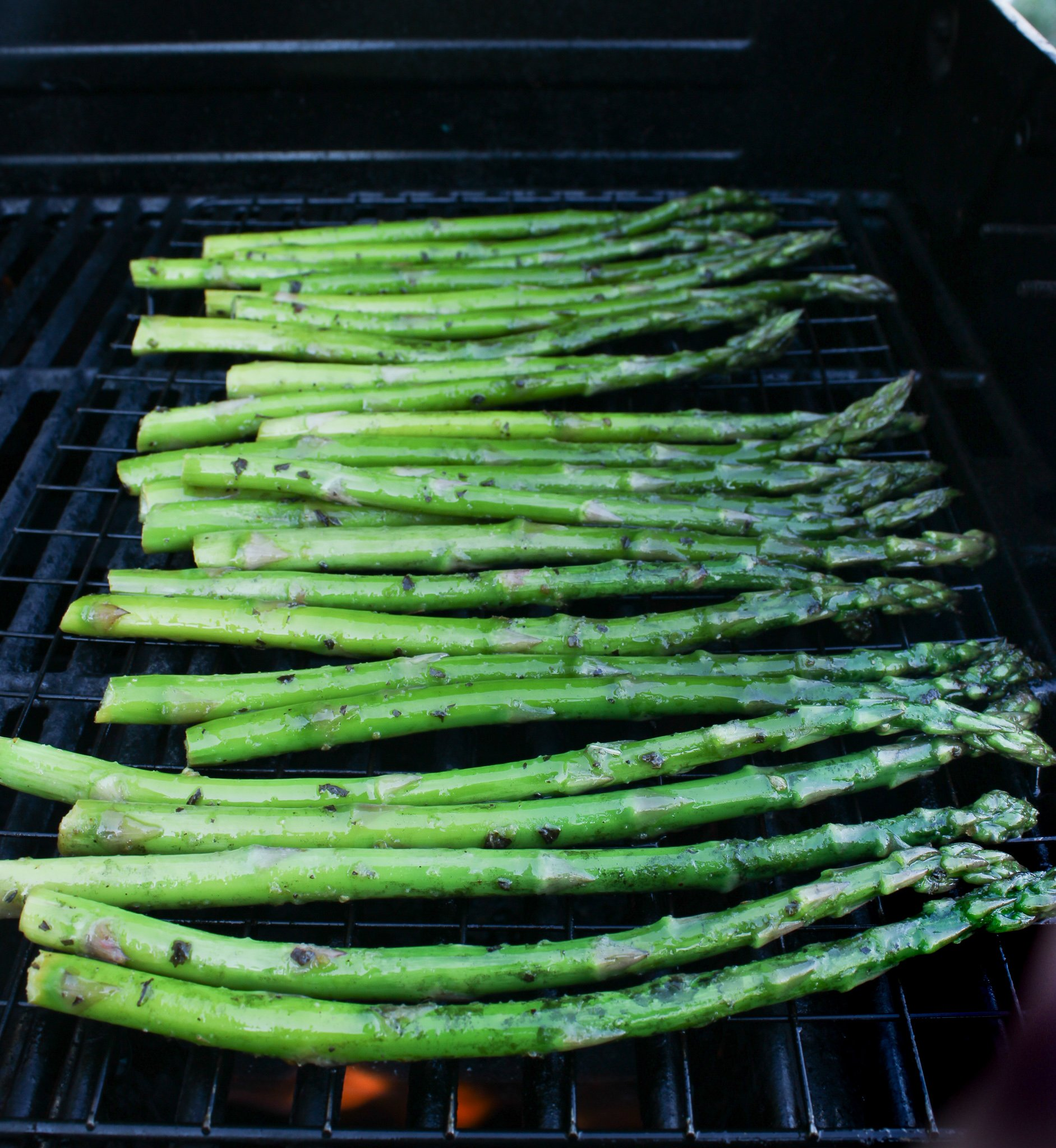 Asparagus being cooked on the grill.